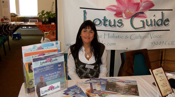 Photo of Dhara sitting at the Lotus Guide Booth